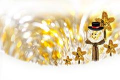 Fond et bonhomme de neige de bokeh de Noël Photographie stock