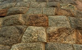 Fond et cadre antiques de texture de mur de fort de bloc en pierre Images libres de droits