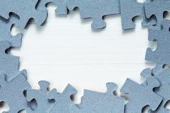 Fond et frontière en bois de puzzle Photo stock