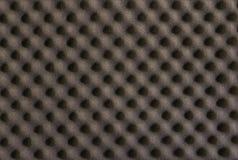 Fond et texture de l'amortissement noir d'éponge Photographie stock libre de droits