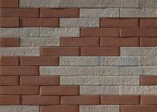 Fond et texture Mur avec les briques rouges et blanches aléatoirement placées Photo libre de droits