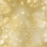 Fond glinstering d'or avec des étoiles et des lumières Photographie stock
