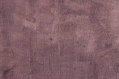 Fond grenu pourpre de texture de plâtre de ciment Images stock