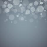 Fond gris avec les lumières defocused Photographie stock libre de droits