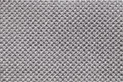 Fond gris-clair de textile avec le modèle à carreaux, plan rapproché Structure du macro de tissu Photos stock