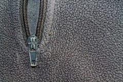 Fond gris de macro de veste d'habillement de tirette Photographie stock libre de droits
