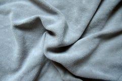 Fond gris, draper doux de tissu de velor Photographie stock