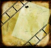 Fond grunge avec le film et la page blanche Images libres de droits