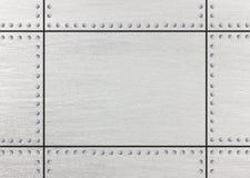 Fond grunge en métal avec des rangées des boulons, 3d, illustration Photographie stock libre de droits