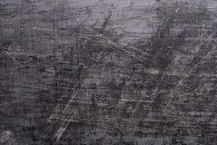 Fond grunge noir avec des éraflures Photo stock