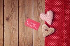 Fond heureux du jour de mère avec des formes de coeur Photo stock