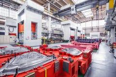 Fond industriel avec des presses Photographie stock