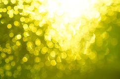 Fond jaune abstrait de tache floue Photo stock