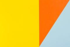 Fond jaune, bleu et orange de papier de couleur Photo libre de droits