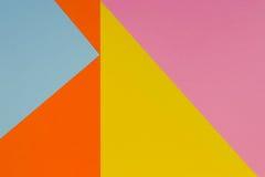 Fond jaune, bleu, pourpre et orange de papier de couleur Images stock
