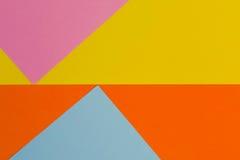 Fond jaune, bleu, pourpre et orange de papier de couleur Photographie stock