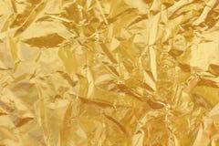 Fond jaune brillant de texture de feuille d'or de feuille Image libre de droits