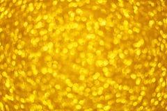 Fond jaune de fête des mères de cercle de forme de Bokeh d'or avec les lumières d'or lumineuses de scintillement pour la Saint-Va photo stock