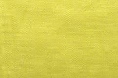Fond jaune de tissu de toile Photographie stock