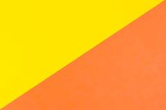 Fond jaune et orange de papier de couleur Photographie stock