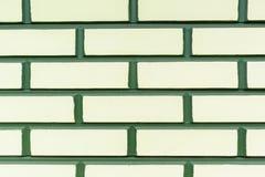 Fond jaune vert de brique de mur Photographie stock libre de droits