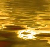 Fond liquide d'or Images libres de droits