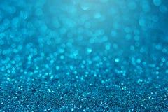 Fond lumineux bleu de bokeh de scintillement Image stock