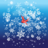 Fond lumineux d'hiver avec des flocons de neige et un oiseau Photo stock