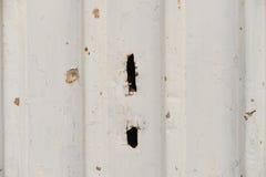 Fond métallique avec le détail de texture d'un mur en métal avec un h Images stock