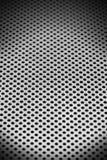 Fond métallique avec les trous ronds images stock