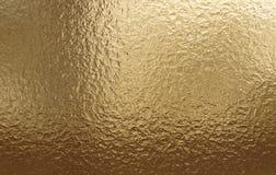 Fond métallique d'or, texture de toile, fond de fête lumineux image libre de droits