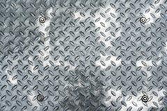 Fond métallique humide Images libres de droits