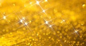 Fond moderne avec l'éclat lumineux et rayonnant d'or illustration de vecteur