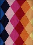 Fond à motifs de losanges de chandail Photo stock