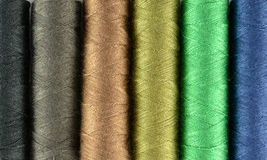 Fond multicolore d'amorçages de couture Images libres de droits