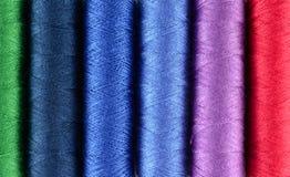 Fond multicolore d'amorçages de couture Photos libres de droits