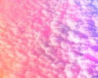 Fond multicolore rosâtre abstrait avec l'effet des nuages Photos libres de droits