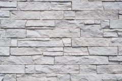 Fond naturel carrelé de mur en pierre - texture en pierre de granit images stock