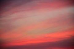 Fond naturel de ciel de coucher du soleil de tache floue Image stock