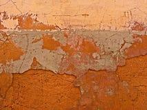 Fond naturel de mur avec des fissures images stock