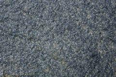 Fond naturel de texture de pierre de colline coloré par obscurité image libre de droits