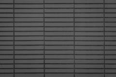 Fond noir de mur de tuile de brique Photo stock