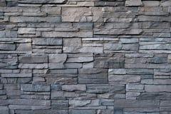 Fond noir de pierre de mur Photographie stock libre de droits