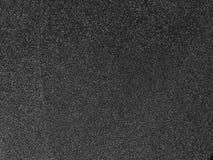 Fond noir de texture de papier à l'émeri Photos stock