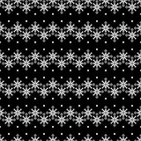 Fond noir et blanc de Noël sans couture avec les flocons de neige et les arbres décoratifs Photographie stock