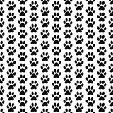 Fond noir et blanc de Paw Prints Tile Pattern Repeat de chien Photographie stock