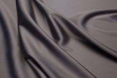 Fond onduleux de texture de plan rapproché de tissu Images stock