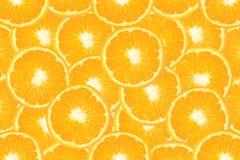 Fond orange découpé en tranches de fruit Photographie stock libre de droits