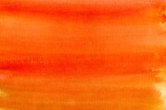 Fond orange d'aquarelle image stock