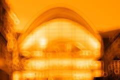 Fond orange de bokeh de bâtiment de sphère Photographie stock libre de droits